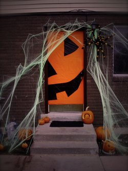 witch silhouette via good housekeeping - Halloween Door Decorating Ideas